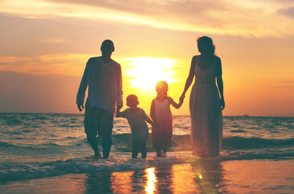 family-having-fun-vacation-with-perfect-sunset
